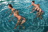 Fitness class using underwater exercise bikes