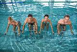 Fitness class doing aqua aerobics on exercise bikes