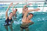 Happy fitness class doing aqua aerobics