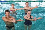 Happy fitness class doing aqua aerobics