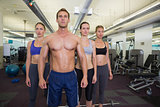 Serious fitness class posing together