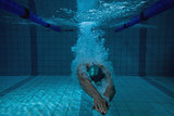 Fit swimmer training on his own