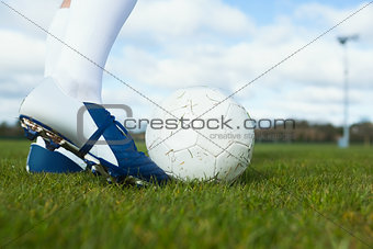 Football player about to kick ball