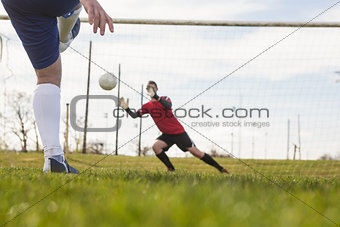 Goalkeeper in red saving a penalty