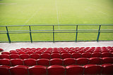 Red bleachers looking down on football pitch