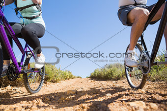 Active couple on a bike ride in the country