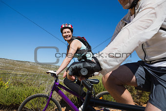 Active happy couple on a bike ride in the country
