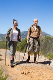 Happy hiking couple walking on mountain trail