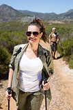 Happy hiking couple walking on mountain trail