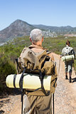 Hiking couple walking on mountain trail