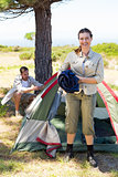 Outdoorsy couple setting up camp in the countryside