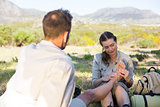Caring girlfriend giving her boyfriend a foot rub on a hike
