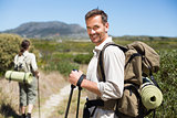 Happy hiking couple walking on country trail