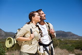 Hiking couple standing and looking on country terrain