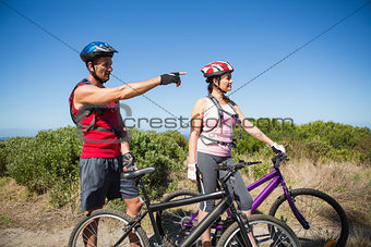 Active couple cycling in the countryside looking ahead