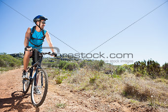 Fit cyclist riding in the countryside