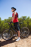 Fit man cycling on mountain trail