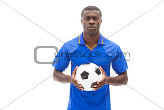 Football player in blue holding the ball