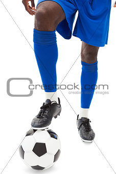 Football players legs with ball