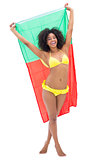Girl in yellow bikini holding up portugal flag smiling at camera