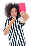 Pretty referee blowing her whistle and showing red card