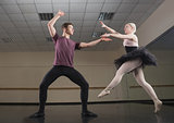 Ballet partners dancing gracefully together