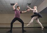 Ballet partners dancing gracefully together