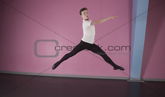 Focused male ballet dancer leaping