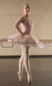 Beautiful ballerina standing en pointe