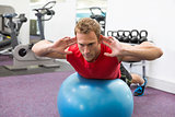 Fit man working his core on exercise ball