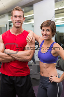 Fit attractive couple smiling at camera