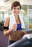 Fit brunette running on the treadmill