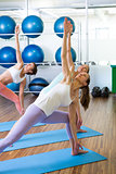 Yoga class in fitness studio