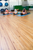 Yoga class stretching in fitness studio