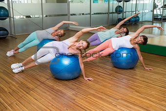 Fitness class on exercise balls in studio