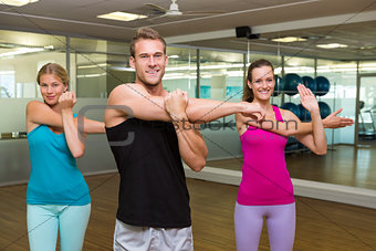 Fitness class led by handsome instructor