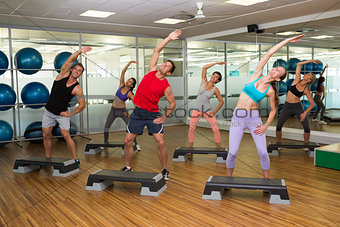 Fitness class doing step aerobics