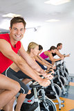 Man smiling at camera during spin class