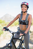 Fit woman going for bike ride