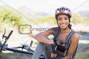 Fit woman taking a break on her bike ride