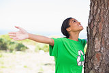 Pretty environmental activist looking up at tree