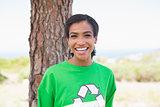 Pretty environmental activist smiling at camera