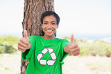 Pretty environmental activist smiling at camera showing thumbs up