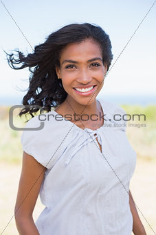 Casual woman smiling at camera