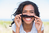 Funny woman making mustache with her hair