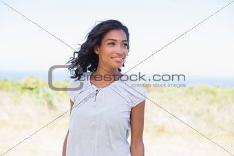 Casual pretty woman standing in the wind