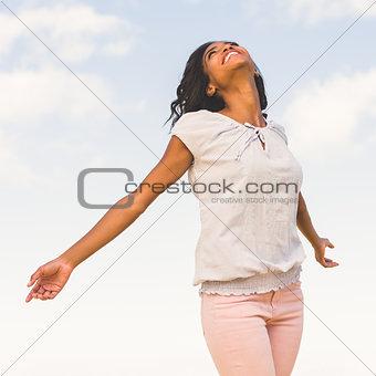 Casual pretty woman enjoying the sunshine