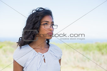 Casual pretty woman wearing reading glasses