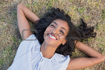 Casual pretty woman lying on the grass
