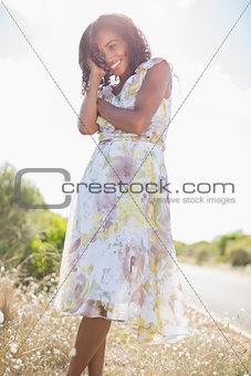 Beautiful woman in floral dress smiling at camera